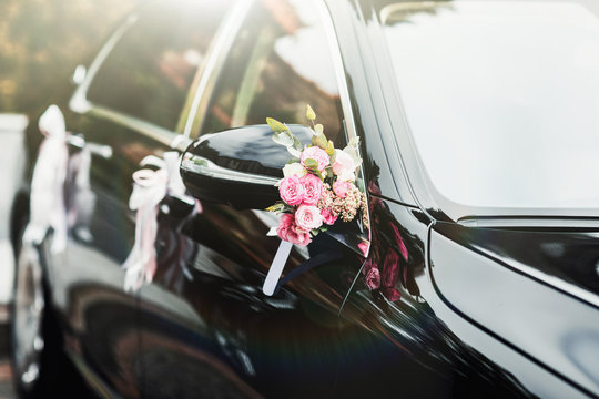 wedding car decorated with flowers and ribbons
