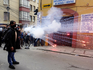 Students from the UPEA (El Alto Public University) shoot fireworks against riot police in La Paz