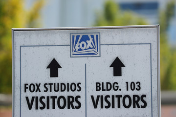 A sign pointing directions is shown at the entrance to Fox Studios in Los Angeles