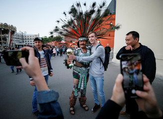 A supporter of the Mexico national soccer team poses for a picture in central Moscow