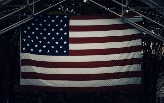American flag hanging from rafters, Dark Background