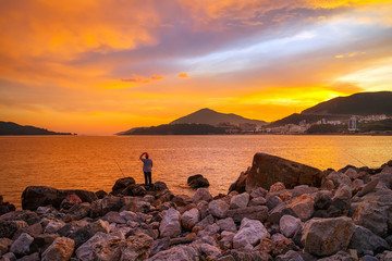 Colorful sunset on Adriatic sea,near the Budva city in Montenegro, gorgeous seascape and nature landscape