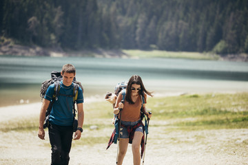 Couple Hiking By The Lake
