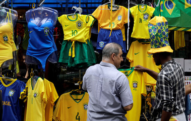 Customers check FIFA World Cup memorabilia in downtown Sao Paulo