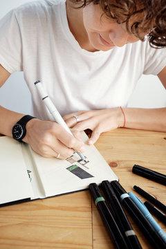 Woman working on design plan