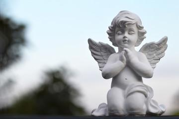 Angel guardian kneeling and praying