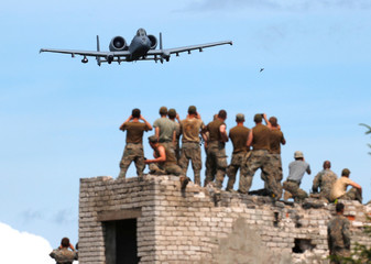 U.S. Air Force A-10 aircraft takes part in the urban fighting drill during the NATO Saber Strike exercise in the Soviet-time former military town near Skrunda
