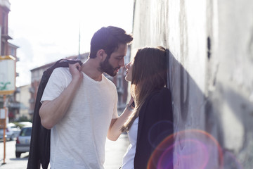 Young cool couple kissing in the city