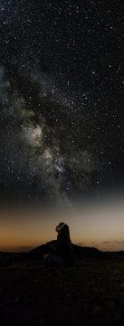 woman enjoying looking stars with music.