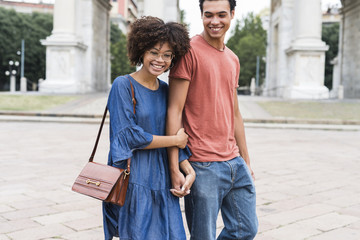 Happy young black couple having fun in the city