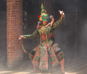 Thotsakan (ten faces giant) in Khon or Traditional Thai Pantomime as a cultural dancing arts performance in masks dressed based on the characters in Ramakien or Ramayana Literature.