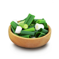 Chopped green onions in a bowl isolated on white background