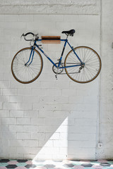 Bicycle hanging on the wall.