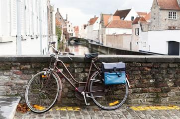 Bicycle on stone bridge in city