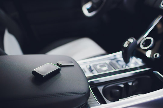 Brand New Car Keys on Leather Closeup. Cars Industry Concept.