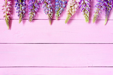 Pink wooden background with flowers