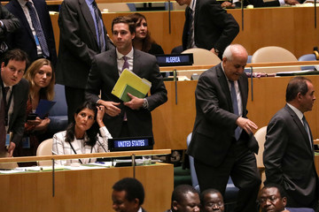 Palestinian Ambassador to the United Nations Riyad Mansour passes U.S. Ambassador Nikki Haley during a vote at U.N. headquarters in New York