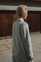 Young stylish woman with great short haircut walking