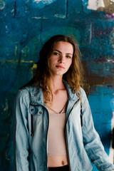 beautiful young woman posing in parking / garage
