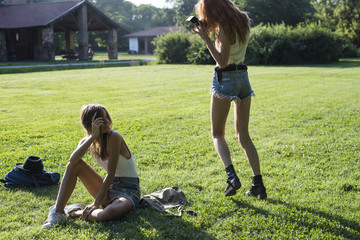 Young friends using an instant camera