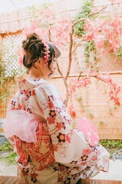 Asian young woman in traditional kimono clothing