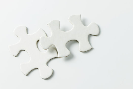 Two pieces of blank white jigsaw puzzle isolated on white background for business conceptual