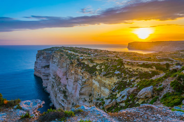 Wall Mural - Sunset view over Ta Cenc cliffs on Gozo, Malta