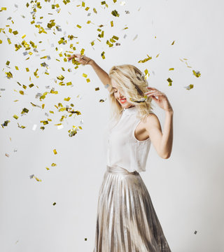 Woman Dancing Under Confetti