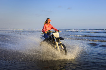 Young woman on a Motocross bike