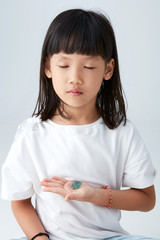 Asian child with a crystal in hand, The state of meditation