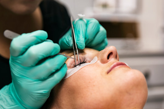 Spa: Aesthetician Applies Eyelash Extensions To Patient
