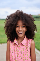 Cheerful lovely girl with afro hairstyle.