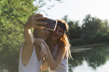 Friends taking a selfie at lake