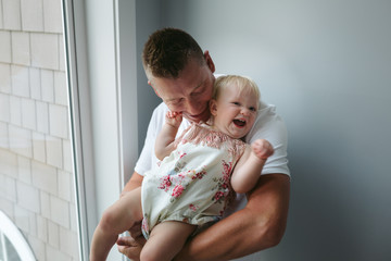 Dad playing with toddler at home