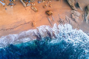 Aerial view of a rocky wild beach