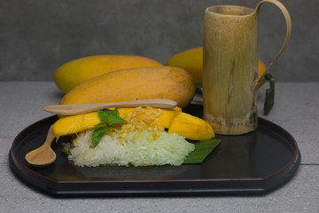 Thai style tropical dessert, glutinous rice eat with mangoes(mango and sticky rice)