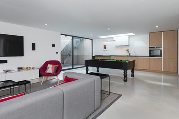 Basement apartment modern decor with pool table at one end.
