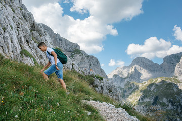Young man with backpack enjoying beautiful landscaped nature.