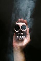 Hand holds handmade skull