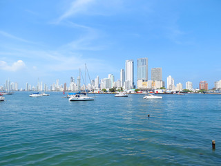 Panoramic view of the coastline of the city and the sea with blue sky with some boats or ships