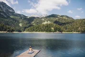 Woman Doing Yoga on Mountain Lake
