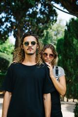 Stylish couple posing at camera