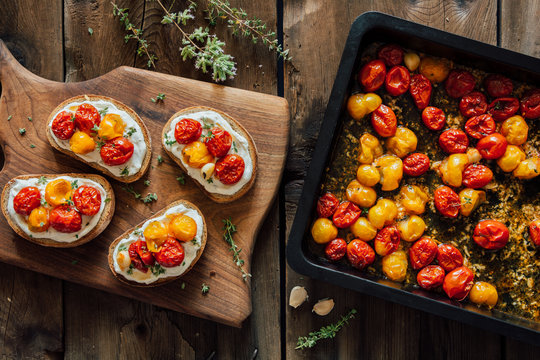 Roasted cherry tomato toasts with cream cheese