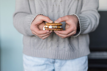 hand holding smore, the Aussie version with chocolate digestives