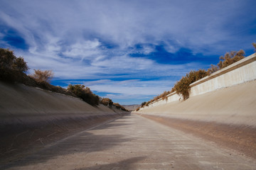 Linear Ditch with Bright Blue Sky