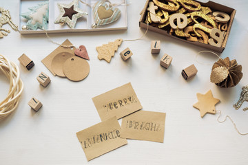 Christmas Decoration And Cards With Stamps On The White Table
