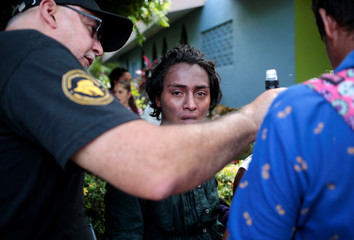 A protester, who had been arrested for participating in a protest against Nicaragua President Daniel Ortega's government, cries after being released by police in Managua
