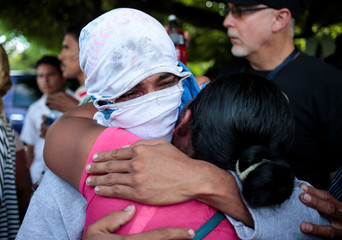 A woman embraces her son who was released by police after being arrested for participating in a protest against Nicaragua's President Daniel Ortega's government in Managua