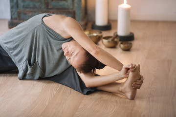 Woman stretching and meditating