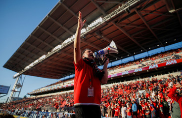 A fan leads the crowd in song as the Toronto FC play D.C. United in their MLS soccer match, at BMO Field, a venue for the 2026 FIFA World Cup, in Toronto